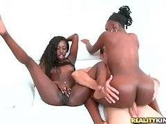 Two naughty black babes are jumping on white cock one by one.