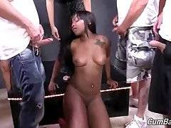Curvaceous black chick readily kneels down and tastes white dicks.